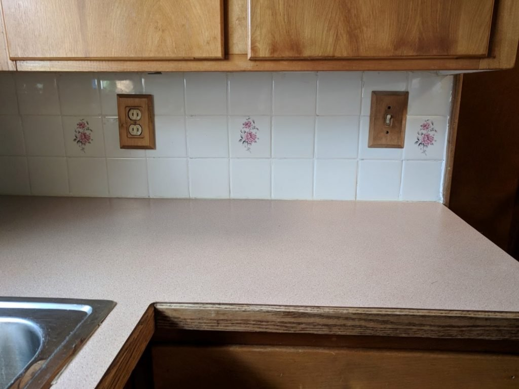 Get a new backsplash and countertop: DIY Kitchen Makeover