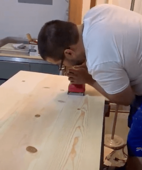 Using a sander on table top