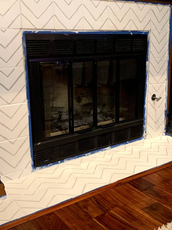 hand painted tile around fireplace